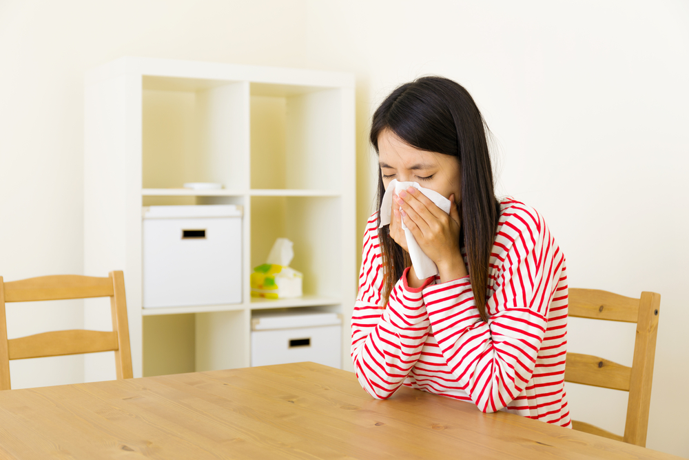 Asian woman sneezing-1