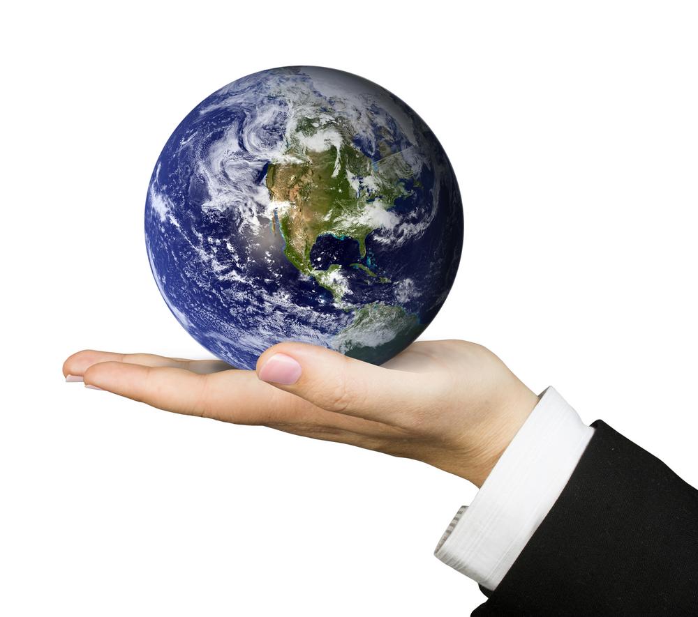 business hand holding globe
